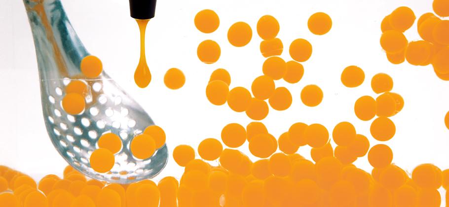 Immersed Mango caviar spheres  with Lotus Spoon')