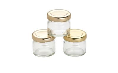 Μικρό χρυσό βάζο μαρμελάδας